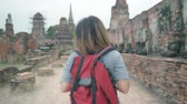 saco : Traveler Asian woman spending holiday trip at Ayutthaya, Thailand, backpacker female enjoy her journey at amazing landmark in traditional city. Lifestyle women travel holidays concept. Stock Footage
