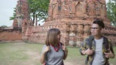 just married : Traveler Asian couple spending holiday trip at Ayutthaya, Thailand, backpacker sweet couple enjoy their journey at amazing landmark in traditional city. Lifestyle couple travel holidays concept.