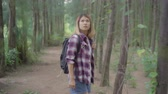 исследовать : Hiker Asian backpacker woman on hiking adventure feeling freedom walking in forest, Female enjoy her holidays near lots of tree. Lifestyle women travel and relax in freetime concept.