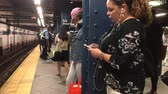 chytrý telefon : New York, June 17, 2017:  Commuters are waiting for a subway train.