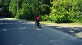 ciclista : Young man biking on a forest road in a sammer day