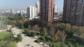 a view : Aerial view of a park and cityscape Stock Footage