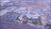 centro : Aerial view of a Shopping center and a park