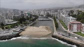 Aerial view of a city and a beach in Chile