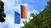 waving : A German and a European flag blowing in the wind Stock Footage