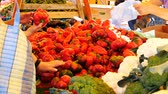 pimiento : CLUJ-NAPOCA, ROMANIA - SEPTEMBER 16, 2017: People buy sweet red peppers at the farmers market