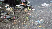 plasticina : Sea water pollution. Environmental pollution. Garbage on the sea. Rippling garbage accumulated over the sea