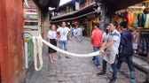 cusine : YUNNAN CHINA - JUNE 22, 2015 :Dessert shop show pulling the traditional nougat on street in old town. Jun 22 ,2015 in Lijiang ,Yunnan, China. Stock Footage