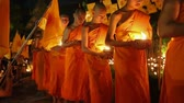 bem aventurado : CHIANG MAI THAILAND - MAY 20 : Visakha Bucha Day is the most important incidents Buddhist day. Buddhist monk fire candles to the Buddha. May 20,2016 in Phan Tao Temple, Chiangmai, Thailand.