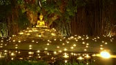 sacred festival : Visakha Bucha Day , candles in religious ceremony ,Chiang mai Thailand.