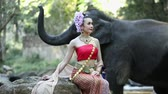 fildişi : Asian woman with elephant in creek ,Chiang mai Thailand. Stok Video