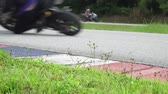 gp : Slow motion- motorcycle practice leaning into a fast corner on track Stock Footage