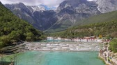 jade : White Water River or Baishui River And Jade Dragon Snow Mountain ,Lijiang ,Yunnan ,China.  Time lapse