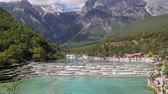 jade : White Water River or Baishui River And Jade Dragon Snow Mountain ,Lijiang ,Yunnan ,China.  Time lapse ,zoom in.