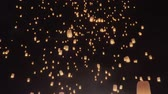 Tourist floating sky lanterns in Loy Krathong festival , Chiang Mai ,Thailand.