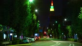 red traffic light : Night time lapse behind neon tower at Harajuku 4K middle shot