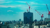 high rise buildings : Cranes on the building in Shibuya time lapse Stock Footage
