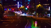 red traffic light : Night busy street at Aoyama avenue time lapse middle shot Stock Footage
