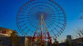 color wheel : Ferris wheel behind the blue sky in Odaiba Tokyo time lapse wide shot