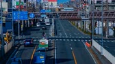 бампер : Rushing cars at the downtown street in Tokyo daytime timelapse middle shot Стоковые видеозаписи