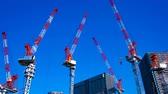 em desenvolvimento : A time lapse of moving cranes at the under construction in Tokyo wide shot zoom