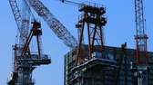 urban development : Cranes at the under construction in Tokyo wide shot Stock Footage