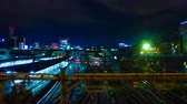 asian architecture : A timelapse of the train at Ueno station at night wide shot