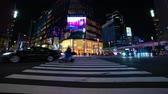 attraversamento pedonale : A timelapse of the street at the downtown in Ginza Tokyo at night long exposure wide shot Filmati Stock