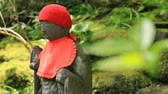 禅 : Japanese statue at the traditional guarden at Hokokuji in Kamakura handheld