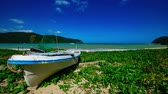 A timelapse of the blue beach near the boat at Kuninao in Amami oshima Kagoshima