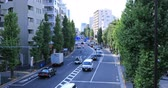 Moving cars at Oume avenue in Tokyo daytime wide shot