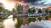Amsterdam Canal houses at sunset reflections time lapse, Netherlands
