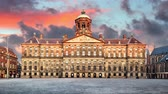 Royal Palace on the dam square in Amsterdam, Netherlands, Time lapse at sunset.
