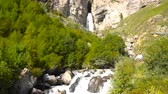 kamie�� : High waterfall Sultan with cascades in the tract Gil-Su high in the Caucasus mountains in summer. Russia, Republic of Kabardino-Balkaria. Wideo