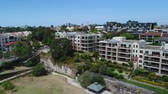 sydney harbour bridge : Drone footage of apartments in Balmain and Sydney skyline Stock Footage
