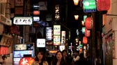 kansai : OSAKA, JAPAN - APRIL 29 : Nightlife with neon lights on back alley street restaurants and bars illuminate near Dotonbori area on April 29, 2017 in Osaka, Japan. Stock Footage