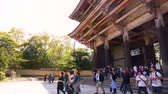 kansai : NARA, JAPAN - APRIL 30 :Tourists and  Japanese walking at the big antique wooden entrance gate to Todaiji temple the most famous temple of Nara city at Todai-ji temple on April 30, 2017 in Nara, Japan