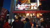 čínská čtvrť : KYOTO, JAPAN - APRIL 29 : Japanese and tourists on the queue at kobe beef steak shop at night , Dotonbori street is the famous food street in Japan on April 30, 2017 in Osaka, Japan