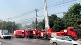 BANGKOK, THAILAND - JANUARY 25 : Fire engine shoot water high in the air to cut some of the toxic haze, Bangkok air pollution reach dangerous levels on January 25, 2019 in Bangkok, Thailand
