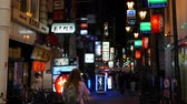 OSAKA, JAPAN - APRIL 29 : Nightlife with neon lights on back alley street restaurants and bars illuminate near Dotonbori area on April 29, 2017 in Osaka, Japan. Stok Video