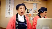 KYOTO, JAPAN - APRIL 28 : Friendly Japanese auntie cashier talking to a customer in supermarket on April 28, 2017 in Kyoto, Japan