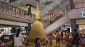 NAKHON PATHOM, THAILAND - APRIL 14 : Hyperlapse of People make sand pagoda during Songkran new year festival. This is an old traditional in Thailand at Nakhon Pathom, Thailand on April 14, 2019