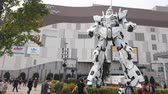 TOKYO, JAPAN - MAY 10 : Unicorn Gundam robot statue in front of the Diver City plaza in Odaiba Shopping mall in Japan on May 10, 2019 in Tokyo, Japan