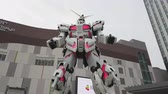 TOKYO, JAPAN - MAY 10 : Hyperlapse of Gundam robot statue in front of the Diver City plaza in Odaiba Shopping mall in Japan on May 10, 2019 in Tokyo, Japan