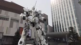 TOKYO, JAPAN - MAY 10 : Hyperlapse of Unicorn Gundam robot statue in front of the Diver City plaza in Odaiba Shopping mall in Japan on May 10, 2019 in Tokyo, Japan