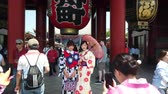 TOKYO, JAPAN - MAY 10 : Tourist wear traditional Kimono take picture with giant red lantern at Sensoji temple (Asakusa temple) the famous and oldest temple in Tokyo on May 10, 2019 in Tokyo, Japan