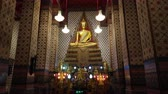 BANGKOK , THAILAND - DECEMBER 31 : Ancient golden Buddha statue inside the temple of Wat Arun in Thailand. Wat Arun is famous Buddhist temple in Thailand on December 31, 2018 in Bangkok, Thailand