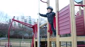 divertido : Cute little boy, sliding down on a pipe