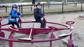 roundabout : Adorable kids, playing on a roundabout Stock Footage