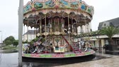 illumination : Merry-Go-Round carousel on a rainy day, reflection on the pavement, France